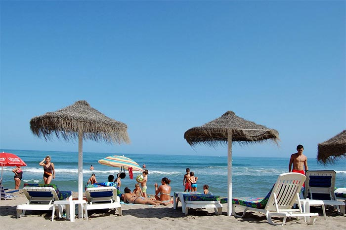 Parasols and sun loungers on the Beach of los Boliches (Fuengirola)
