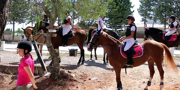 Children in a horse-riding class in Lauro Golf